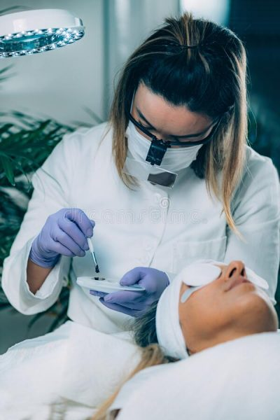 lash-lifting-beauty-salon-beauty-treatment-cosmetologist-puts-black-paint-eyelashes-lash-lifting-procedure-200855371